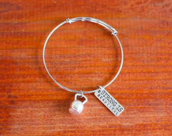 """Stainless Steel Adjustable """"Strong Is Beautiful"""" Bangle Bracelet"""