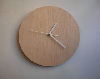 Wall clock made of plywood. Silent.