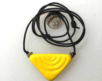 Yellow African Trade Glass Pendant on 2 Knot Cord.
