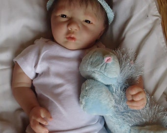 Reborn Miranda Awake a Realborn sculpt.Miranda is a sweet baby girl (Asian looking features ) looking for her forever Mom to cuddle with