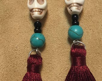 Skull earrings with turquoise and maroon tassles