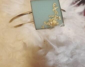 pale teal and goldtone adjustable cuff bracelet