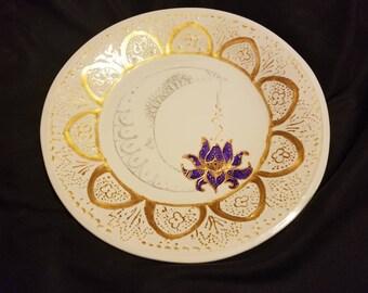 Sun, moon, and lotus plate