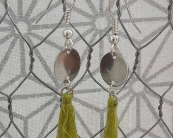 Dangling earrings with lime green tassels