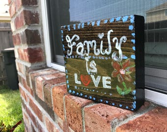 Family is love wooden quote block