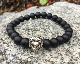 Men's stretch black Onyx semi-precious stone beaded bracelet with silver or gold lions head.