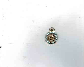 a feb.sign the fishes pendant with 2 stones missing