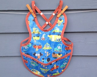 Waterproof PUL baby bib, adjustable, animals in cars print with snaps and pocket