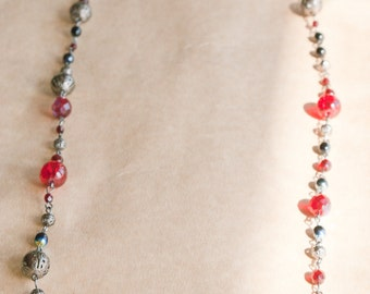 Long red, black and gun-metal glass and metal beaded necklace