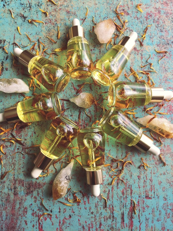 Floral infused facial serum made with argan oil balance and restore facial serum