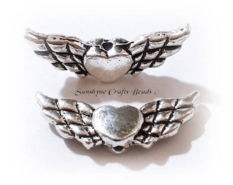 """Antique silver-plated """"pewter"""" (zinc-based alloy), 22x9mm double-sided angel wings with heart. Sold per pkg of 20"""