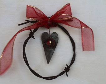 handmade rusty barbed wire Chistmas ornament with heart and bell