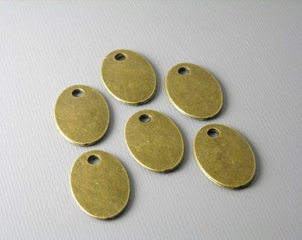 CHARM-DISC-ov-AB-17MM - Antique Bronze Oval Discs - 10 pcs