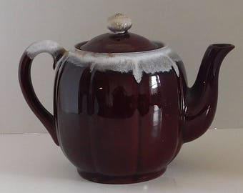 Brown Teapot marked Japan with drip glaze