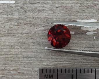 One 6mm faceted Mozambique red garnet semiprecious gemstone