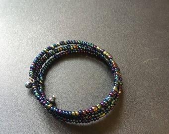 Multicoloured beads in memory wire bracelet