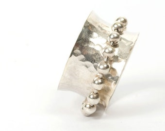 Concave hammered silver ring with moving balls