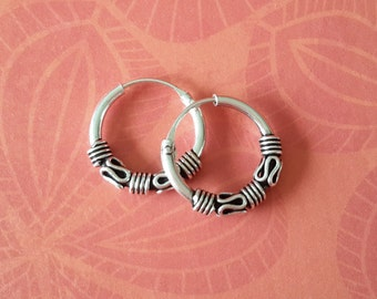 Silver loops small ornate