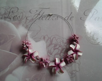 White tiare flowers and fuschia ceremony necklace
