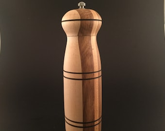 Pepper grinder made from walnut , oak and maple.