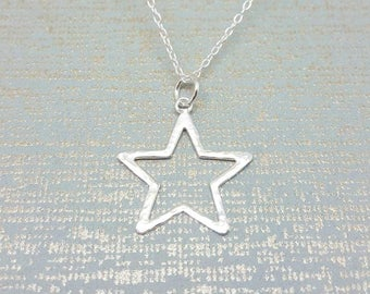 Sterling silver star necklace / Hammered star pendant / modern stacking necklace / Handmade in the UK / Silver pendant