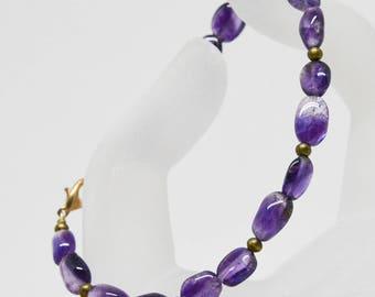 Lovely purple tone beaded bracelet