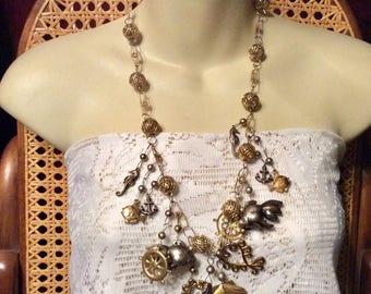 Vintage 1960s metal seashell, seahorses, starfish, ships wheel charms necklace.
