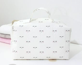Lined with water-repellent canvas toiletry baby shaped vanity box patterned soft powder pink color sleepy eyes black and white