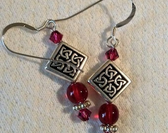 Ruby and silver pierced earrings with Celtic knot beads.