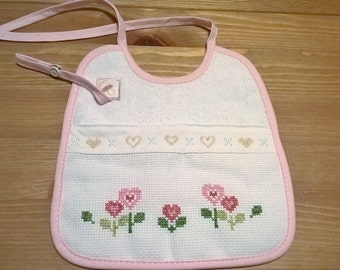 Baby bib with pacifier