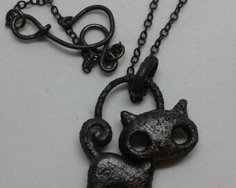 Creepy copper kitty