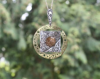 Ornament lace jewelry. Silver mixed metals necklace with rutilated quartz. Geometric necklace.