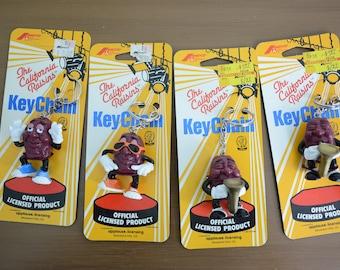 California Raisins Key Chains - Sunglasses, Blue Shoes, Saxophone, 80s Cartoon, Calrab, Orange Sunglasses, Blue Shoes, Saxaphone