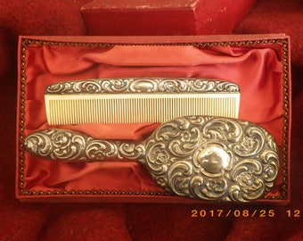 Edwardian childs silver brush and comb set.