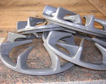Set of four cooktop iron grates