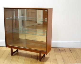 Turnidge Of London Mid Century Bookcase in Teak With Sliding Glass Doors and Mirrored Back