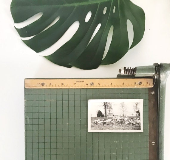 small industrial green wood paper cutting board with cast iron handle / office supplies