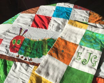 This is an adorable set of The Very Hungry Caterpillar book series licensed design quilt and monogramed matching burb cloth.