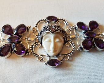 Goddess bracelet with amethyst colored stones