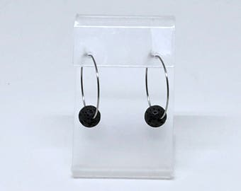 Earrings with lava stone and stainless steel rings