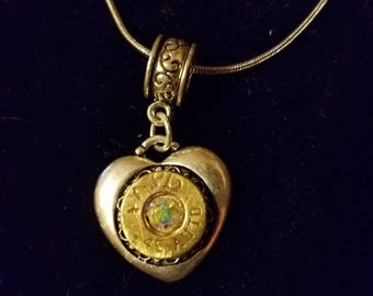 Heart necklace recycled .45  brass casing. Bling in the center of casing. myself or my husband shot them