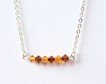 Necklace in silver metal beads and Swarovski bicones ochre/Brown