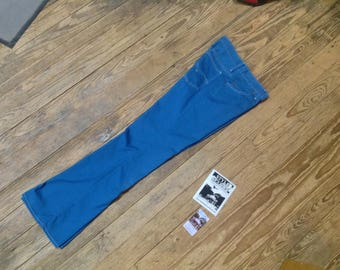 "LEVIS Big E Bellbottom/Flares size 27""W x 30""L in Good Cond."