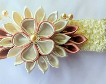 Ivory colored kanzashi flower headband for baby girl.