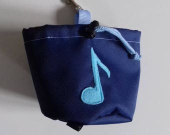 Navy blue dog treat pouch with a note motif