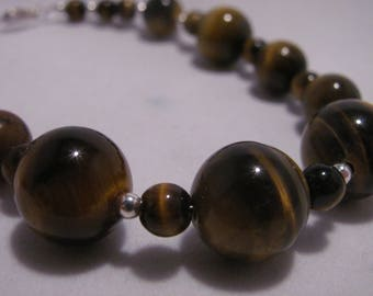 tigers eye bead bracelet with silver colored accent beads with lobster claw clasp