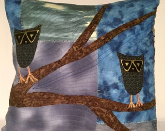 Square quilted pillow with appliqué owls