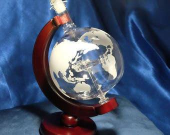 Spinning Whiskey Decanter with Etched World Map and Warplane Ornament - 650ml
