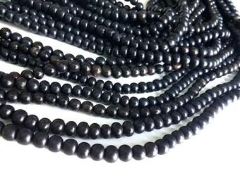 Perles en corne naturelle noire 7mm