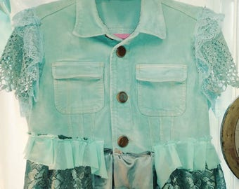 Aqua embellished corduroy vest.